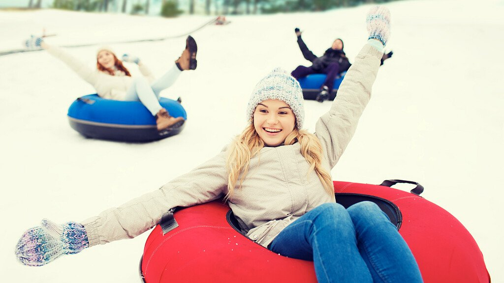 Snow tubing in holiday region Three Peaks in the Dolomites - cover