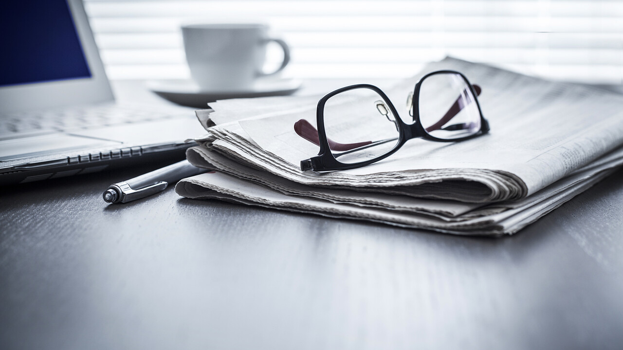 Newspapers with pc and glasses