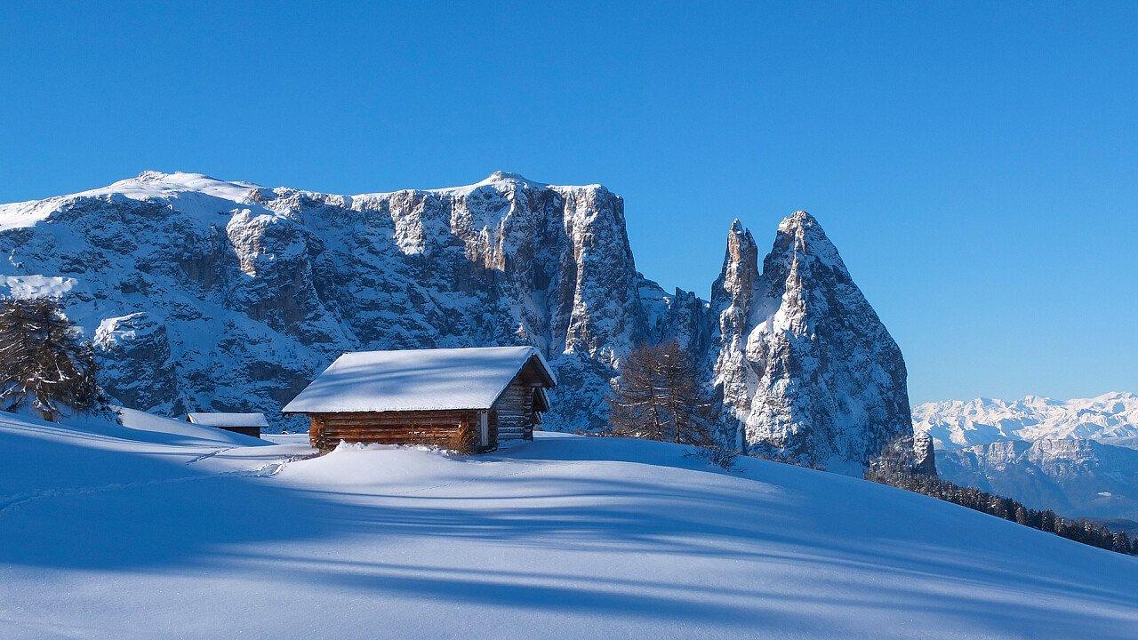 winter hut close to sciliar alpe di siusi