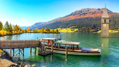 Jetty with the boat at Resia lake
