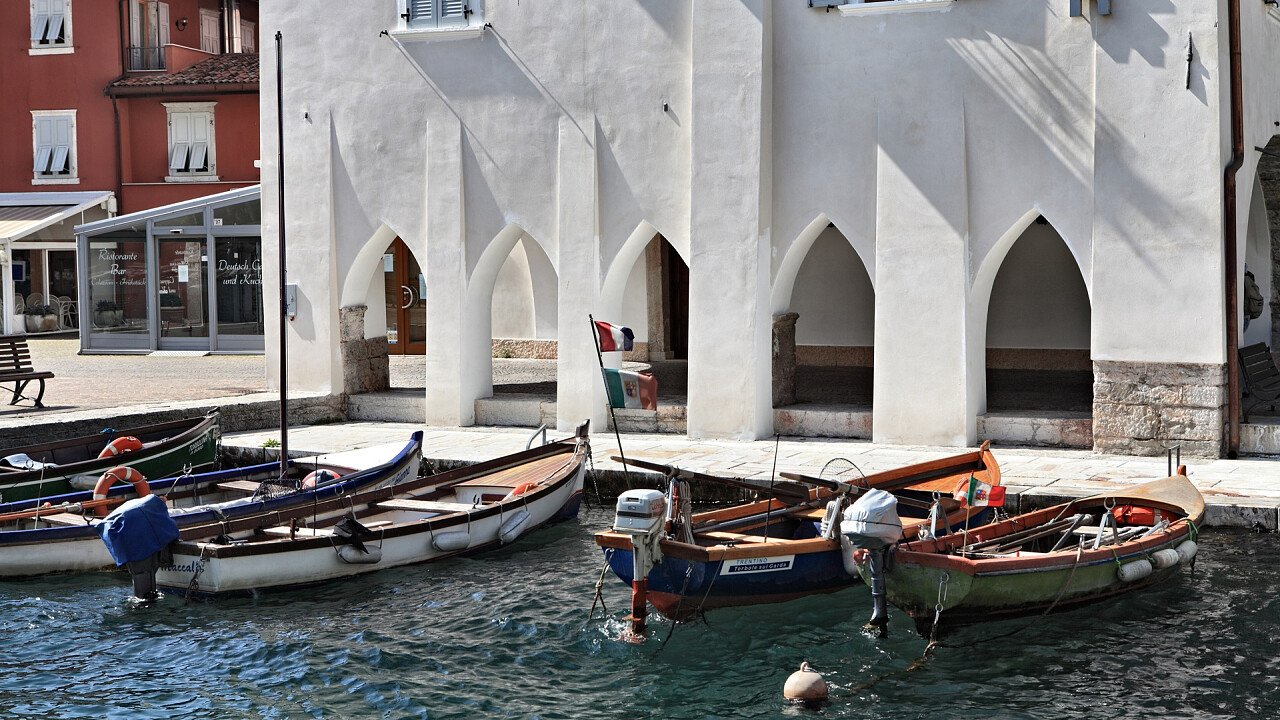 Boats under the arcades in Nago-Torbole